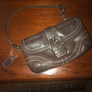 Coach dark brown leather wristlet.